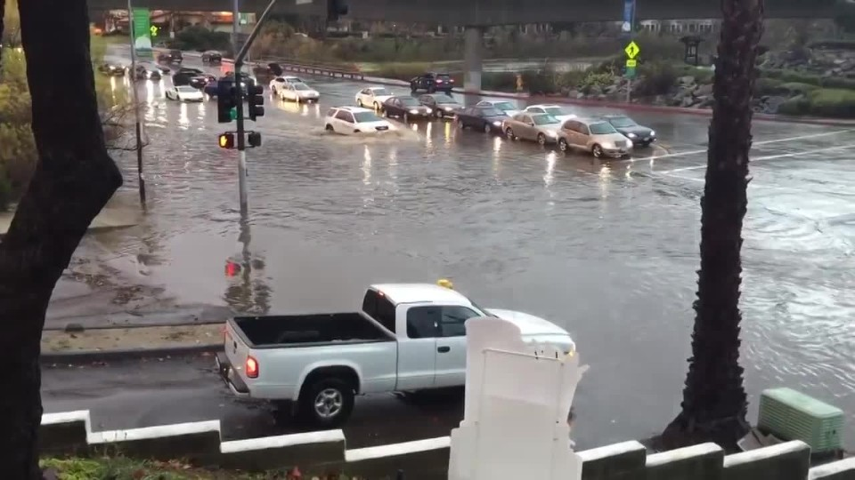 Lamborghini driving through San Diego flood